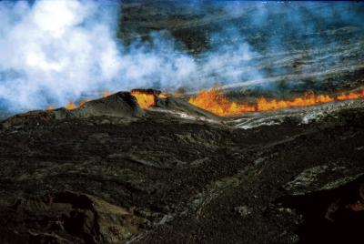 Hawaii, Mauna Loa volcano erupting, fiery lava flow and smoke down mountain of hard rock