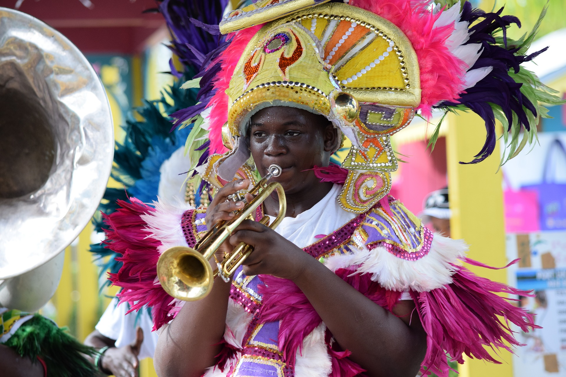 Bahamian woman in parade garb playing a trumpet