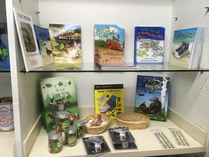 Children's books in a glass display case